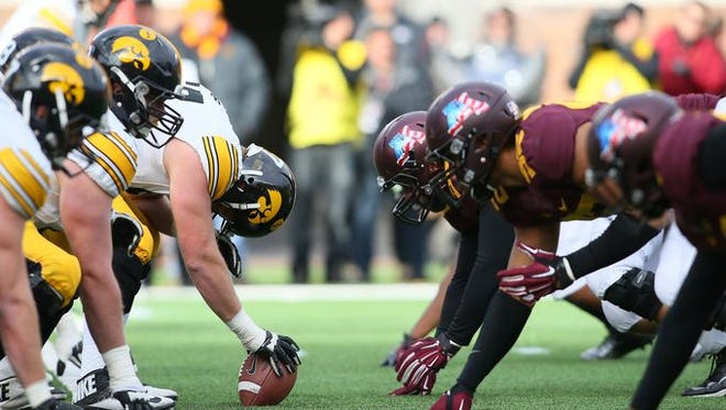Minnesota dominated Iowa at  the line of scrimmage