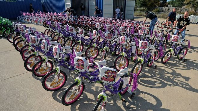 More than 200 bicycles and $1,500 worth of toys were purchased by Friends of Bear — a local motorcycle group — at the Wal-Mart in Gulf Breeze on Sunday morning, ready to make Christmas brighter for hundreds of local children.