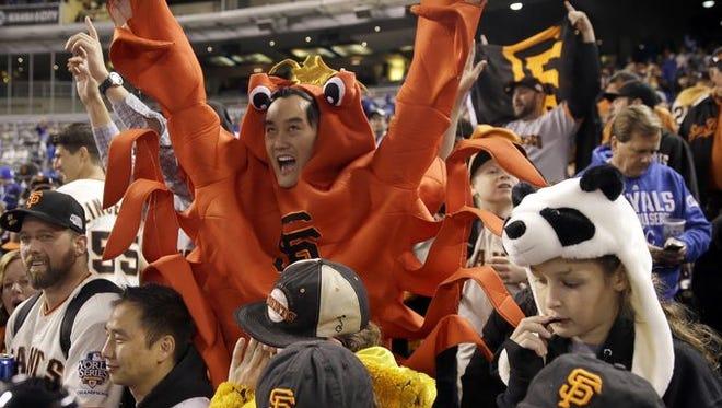 Giants fans celebrate the San Francisco team's 2014 World Series win.