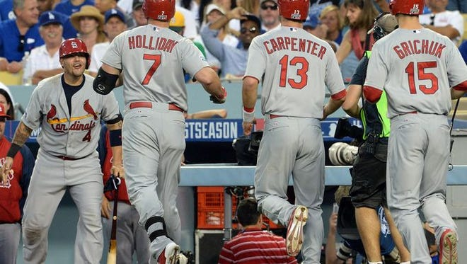 FILE- Game 1 in Los Angeles - Cardinals 10, Dodgers 9: Matt Holliday hits a three-run homer in the seventh inning to gIve the Cardinals a 10-6 lead.