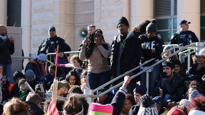 Protesters gathered in downtown St. Louis Tuesday, Nov. 25 and marched to the federal courthouse in response to the decision announced Monday by the grand jury.