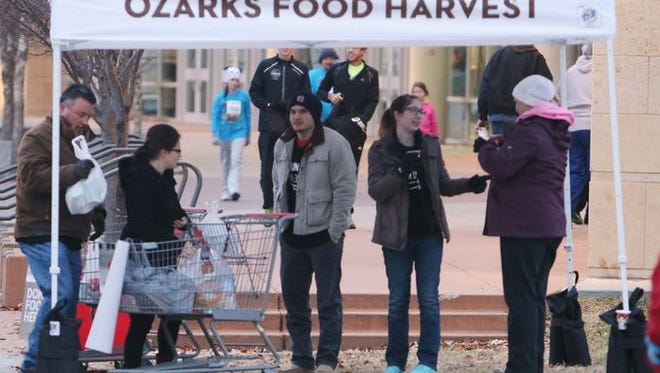 Thousands of runners and walkers participated in the 20th Annual Turkey Trot. The Ozarks Food harvest was one of the charities to benefit.