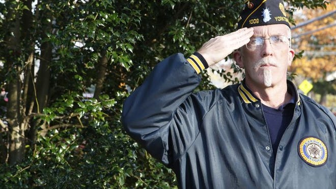 Pat McDonough with American Legion Post 1009, salutes during Taps at the Shrub Oak Veterans Memorial during the Yorktown Citizens Veterans Day Committee annual Veterans Day Parade and observance in Shrub Oak on Nov. 9, 2014.