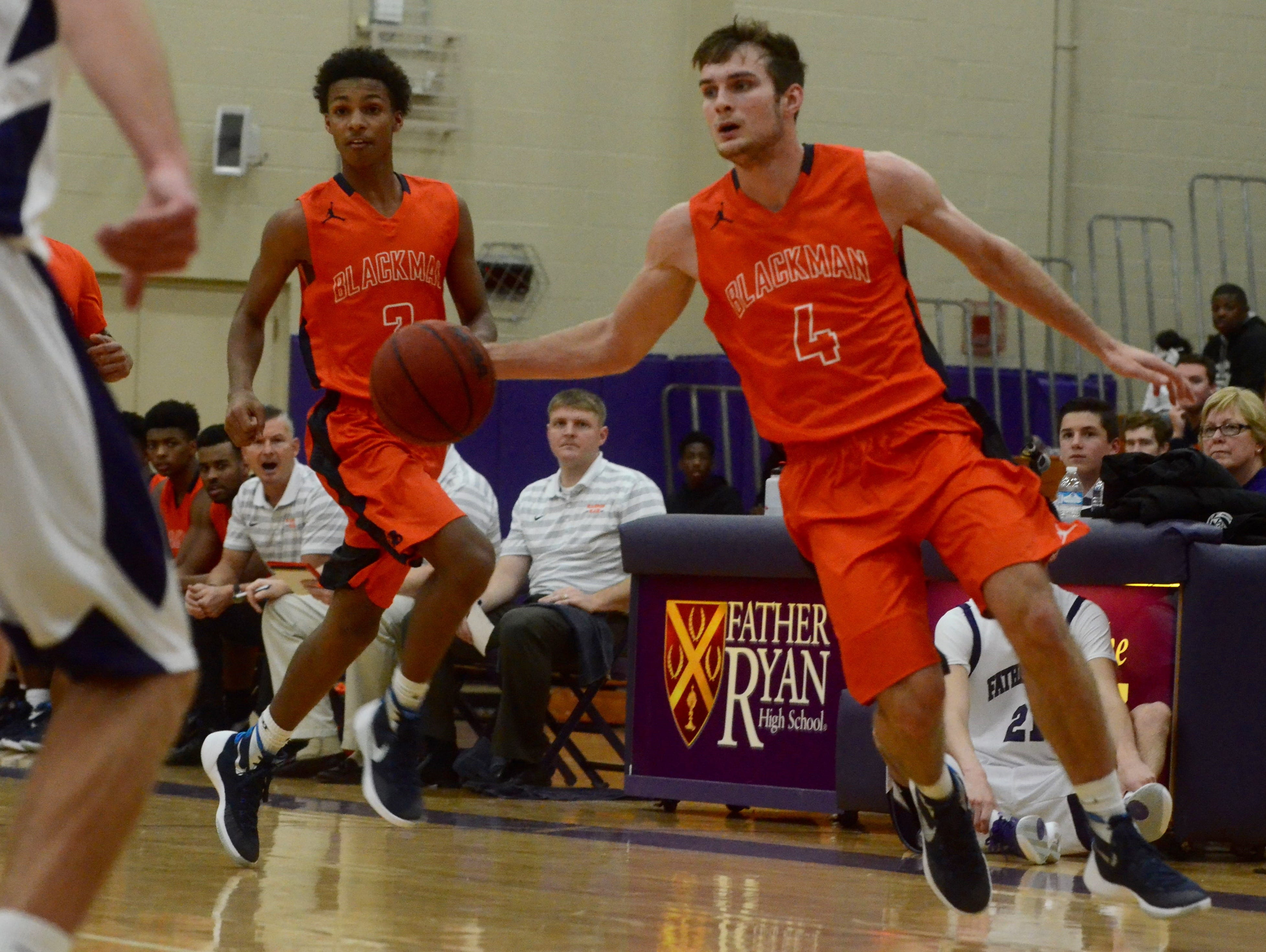 Blackman's Christian DeWitt (4) starts a fast break while teammate Donovan Sims (3) trails during Wednesday's championship game of the Willie Brown Invitational on Wednesday at Father Ryan.