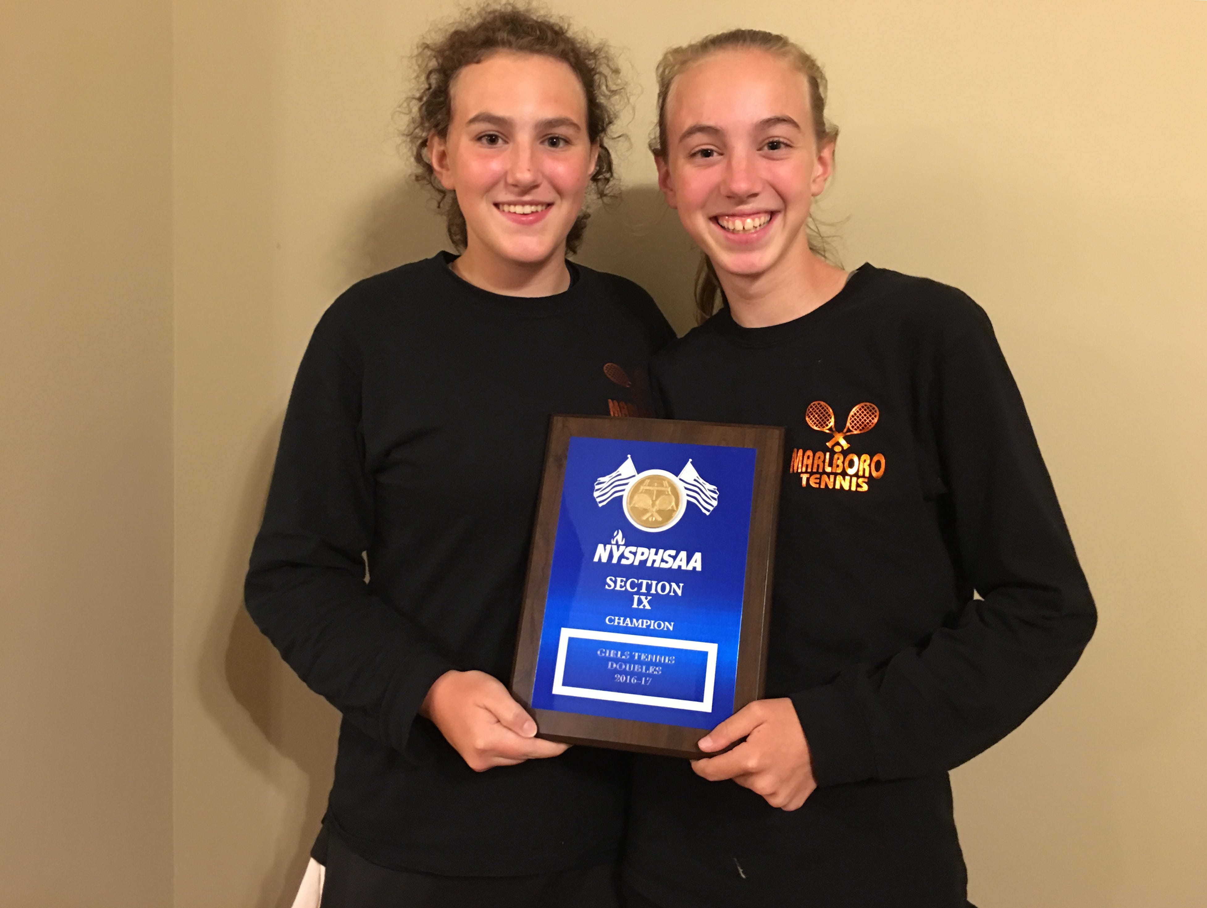 Emma Messenger and Grace Messenger won the Section 9 girls tennis doubles title on Monday.