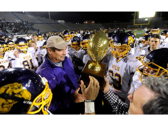 Wylie head coach Hugh Sandifer celebrates with the team after winning in the 2016 Class 4A Div. I state quarterfinal. This will be Sandifer's 40th season-opener on the Wylie sideline after seven years as an assistant and now 33 as head coach.