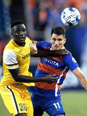 Nashville SC midfielder Bolu Akinyode (30) blocks FC Cincinnati forward Danii Konig from the ball on Saturday, July 7, 2018 at Nissan Stadium in Nashville, Tenn.