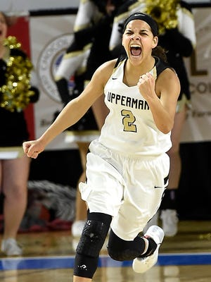 Akira Levy (2) is excited after scoring and drawing a foul in the closing minutes as Pearl Cohn plays Upperman in Division I, Class AA girls basketball state semifinals  Saturday March 11, 2017, in Murfreesboro, Tenn.