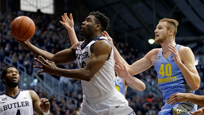 Butler's Kelan Martin drives past Marquette's Sam Hauser for two of his game-high 22 points Monday.