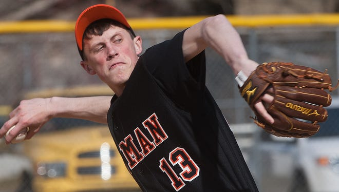 Pitman's Eric Stafford throws against Pennsville during the first inning of the game at Pitman. 04.09.14