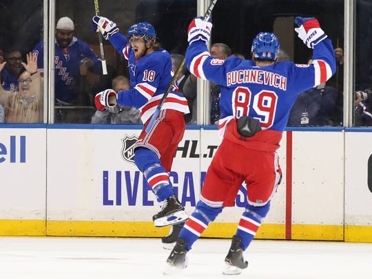 New York Rangers defenseman Marc Staal (18) celebrates his goal with Pavel Buchnevich (89) during the first period of the team's NHL hockey game against the Winnipeg Jets, Thursday, Oct. 3, 2019, at Madison Square Garden in New York. (AP Photo/Mary Altaffer)