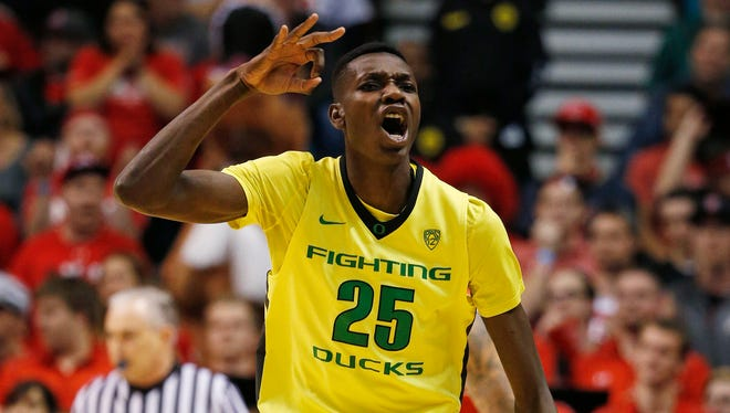 Oregon forward Chris Boucher reacts after scoring a 3-point shot against Utah during the first half of an NCAA college basketball game in the championship of the Pac-12 men's tournament Saturday, March 12, 2016, in Las Vegas.