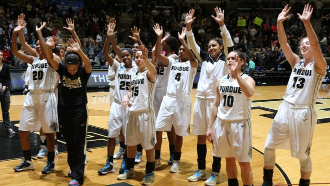 The Purdue Boilermakers players salute to their fans after defeating the Akron Zips in the first round of the NCAA Tournament at Mackey Arena. The Boilermakers won 84-55.