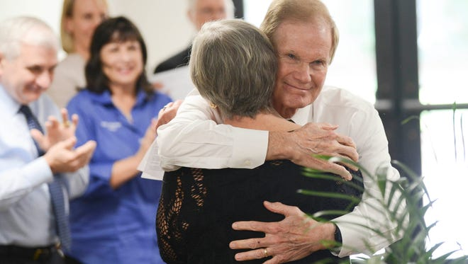 U.S. Sen. Bill Nelson hugs Trinity Towers resident Martha Szopinski during a dedication of the newly renovated Trinity Towers complex in March 2018.