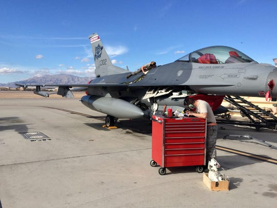 Crew chiefs with the 115th Fighter Wing perform routine