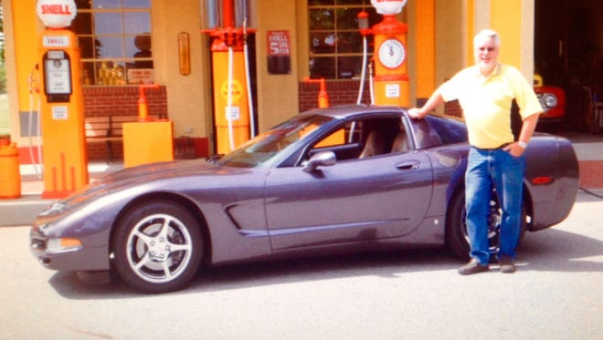 Event chairman Jim Rees with his purple pearl Corvette.
