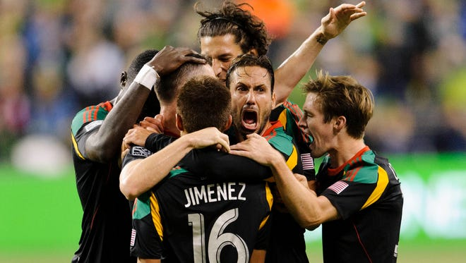 The Los Angeles Galaxy celebrates after forward Robbie Keane scored a goal against the Seattle Sounders at CenturyLink Field.