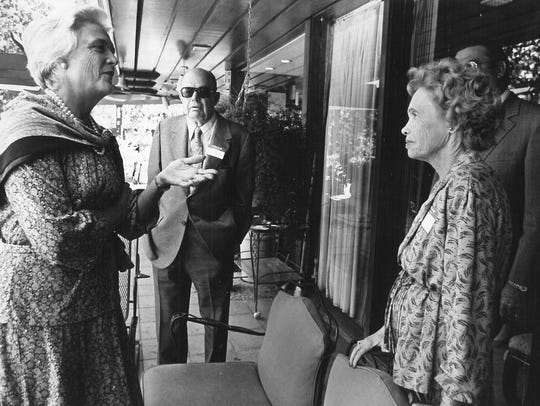 Barbara Bush talks with Mr. and Mrs. Hal Sayles in Abilene, while on the presidential campaign of her husband, George H.W. Bush, on Oct. 23, 1979.