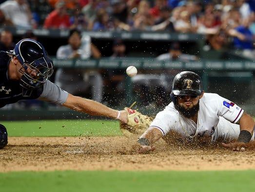Texas Rangers second baseman Rougned Odor (12) steals