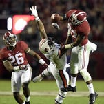 Nov 29, 2014; Tuscaloosa, AL, USA; Alabama Crimson Tide defensive back Nick Perry (27) and Landon Collins (26) break up a pass intended for Auburn Tigers wide receiver D'haquille Williams (1).