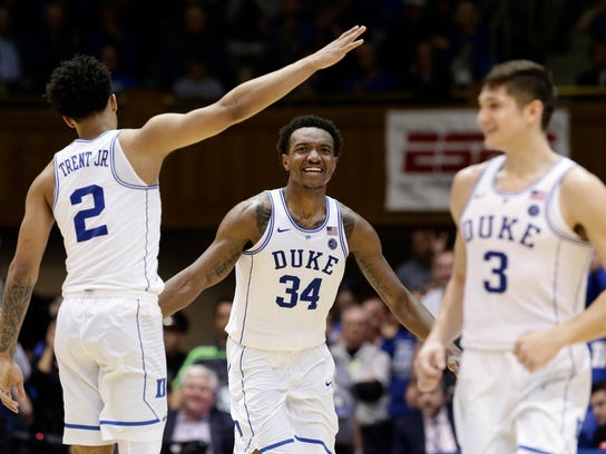 Duke's Gary Trent Jr. (2), Grayson Allen (3) and celebrate with Wendell Carter Jr. (34) celebrate following Carter's basket against Virginia Tech during the second half of an NCAA college basketball game in Durham, N.C., Wednesday, Feb. 14, 2018. Duke won 74-52. (AP Photo/Gerry Broome)