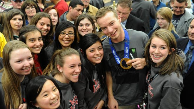 David Wise is surrounded by Wooster High School students Thursday at a homecoming celebration at Reno-Tahoe International Airport.