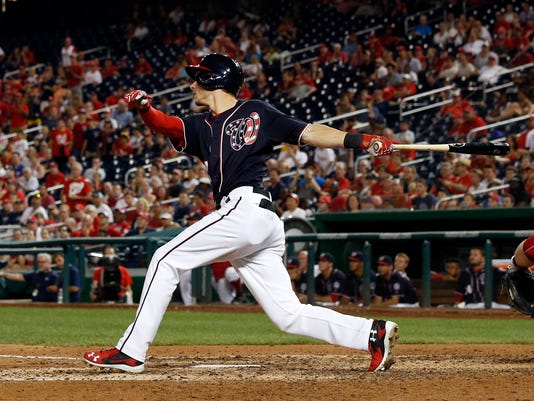 Washington Nationals' Trea Turner follows through on his game-winning solo home run during the ninth inning of a baseball game against the Philadelphia Phillies at Nationals Park, Friday, Sept. 9, 2016, in Washington. The Nationals won 5-4. (AP Photo/Alex Brandon)