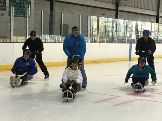 Operation Beachhead participants hit the rink for some ice skating and hockey in adaptive sleds.