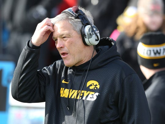 Iowa Hawkeyes football coach Kirk Ferentz watches his team against the Purdue Boilermakers.