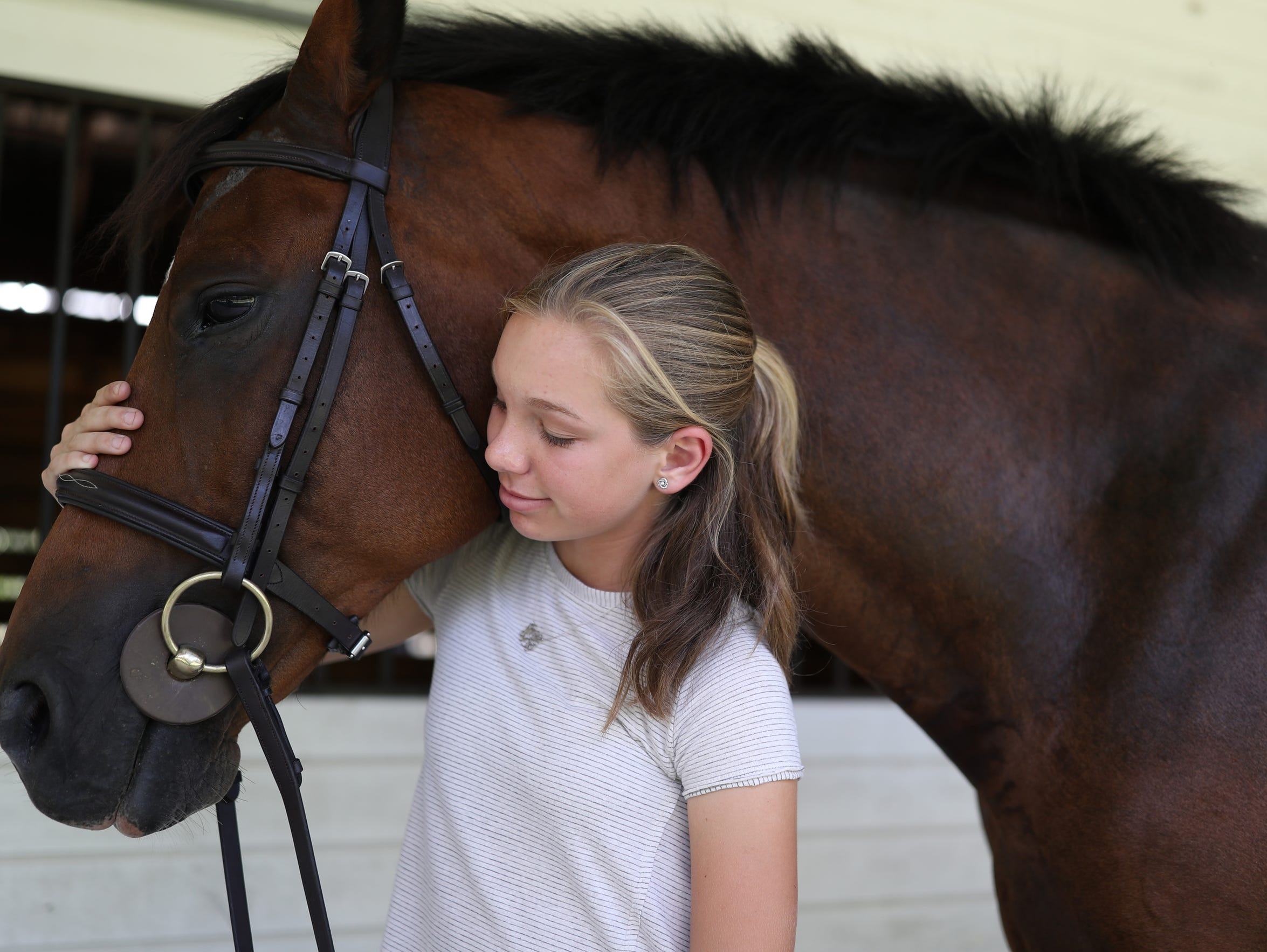 Madeline Jordan, 13, with her horse Bacon on the family