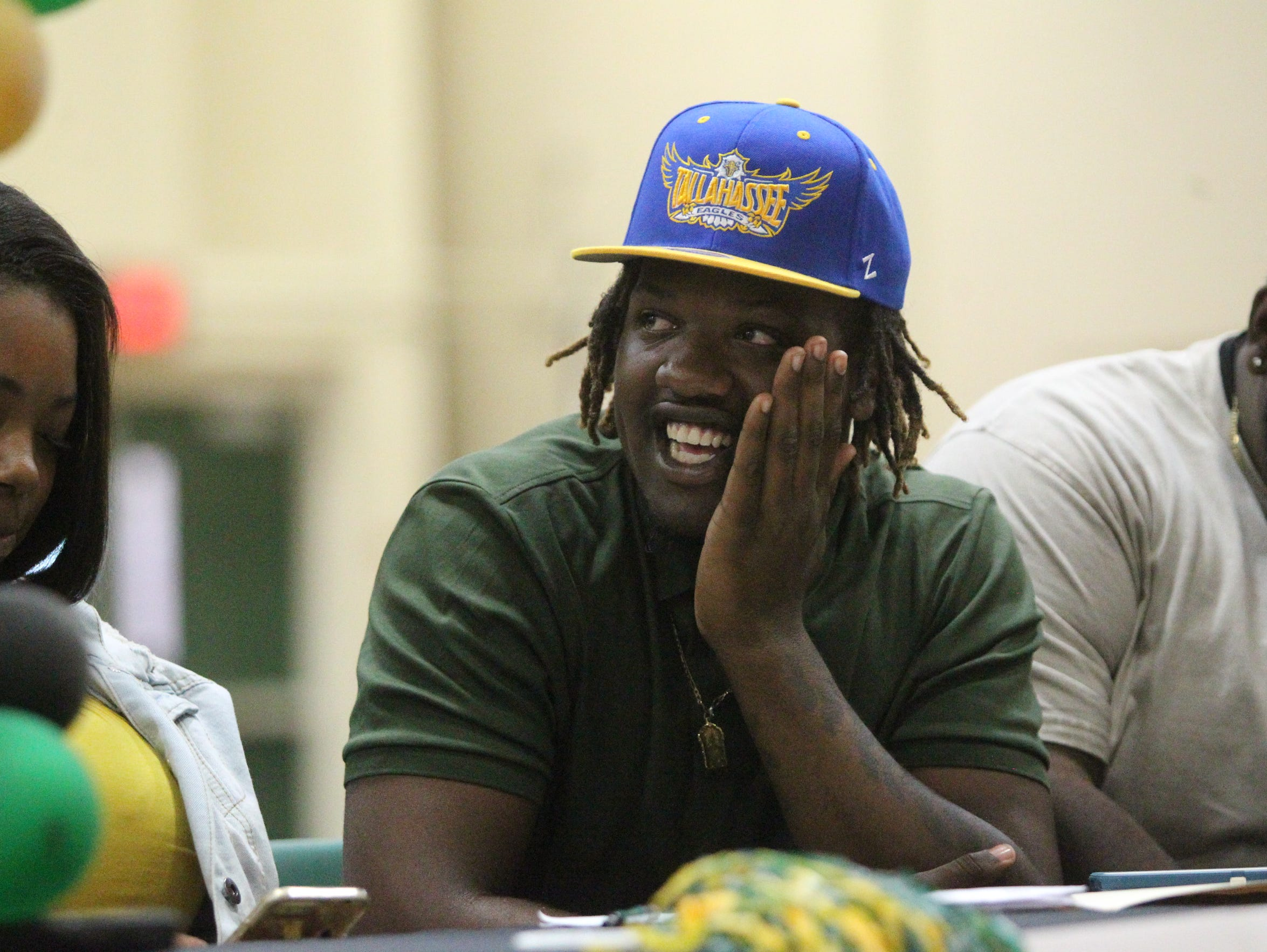 Lincoln High senior Tyler Farmer was all smiles after