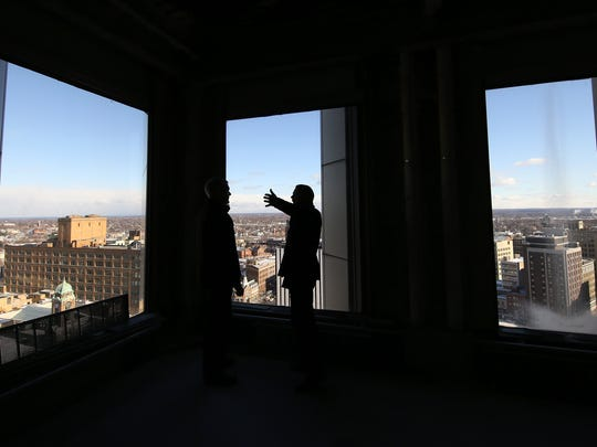 Patrick Dutton looks north east from the 17th floor of Chase Tower. Dutton has teamed up with Gallina Development Corp to create a mixed-use site at Chase Tower to feature retail, condominiums and apartments.