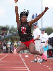 Hilton's Anaya Dees in the triple jump competition during the 2018 high school state championships in Cicero, New York.
