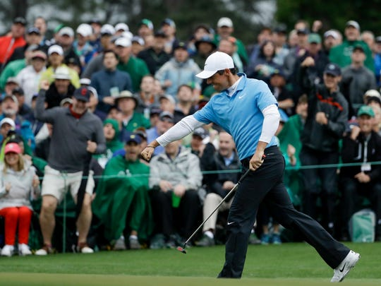 Rory McIlroy is pumped up after sinking a birdie putt on the 18th hole during the third round of the Masters. McIlroy will be in the final pairing on Sunday as he tries to complete his career Grand Slam.
