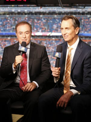 Al Michaels (l) and Cris Collinsworth, shown here during a regular-season game, were a please to hear during the Super Bowl.