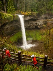 Runners pass the South Falls at Silver Falls State