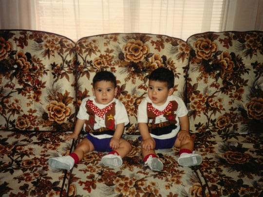 Twins Kristopher and Kevin Chavez, at about one year old.