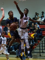 Pocomoke's Tyrone Matthews (14) takes a shot on net
