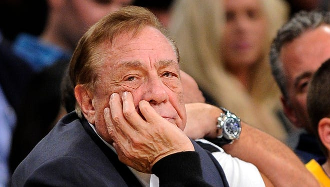 FILE - In this Feb. 25, 2011, file photo, Los Angeles Clippers owner Donald Sterling looks on during the first half of their NBA basketball game.