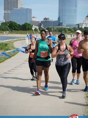 Ronetta Watson (center) runs the half marathon of the