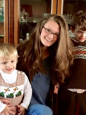 Jenn Hearn at home with her two sons.