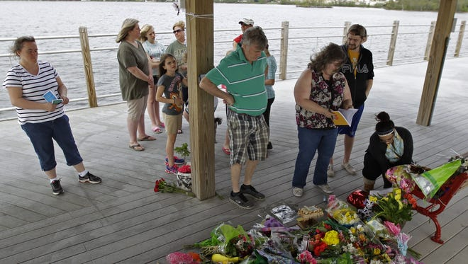 A prayer service for the victims of Sunday's shooting and their families, part of the National Day of Prayer, at Fritse Park near the entrance to the Fox Cities Trestle Trail bridge on May 7, 2015 in the Town of Menasha, Wis. On May 3, 2015, 31-year-old Adam Bentdahl, 33-year-old Jonathan Stoffel and Stoffel's 11-year-old daughter Olivia, were shot and killed on the Trestle Trail bridge. Erin Stoffel, 32, suffered three gunshot wounds and is in serious condition at Theda Clark Medical Center.