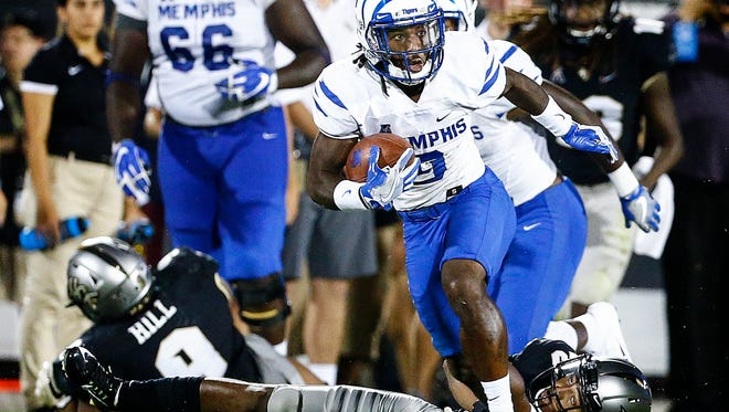 Memphis receiver John Williams (top) runs by Central Florida defender Tre Neal (bottom) during the first quarter action Saturday, Sept. 30, 2017.