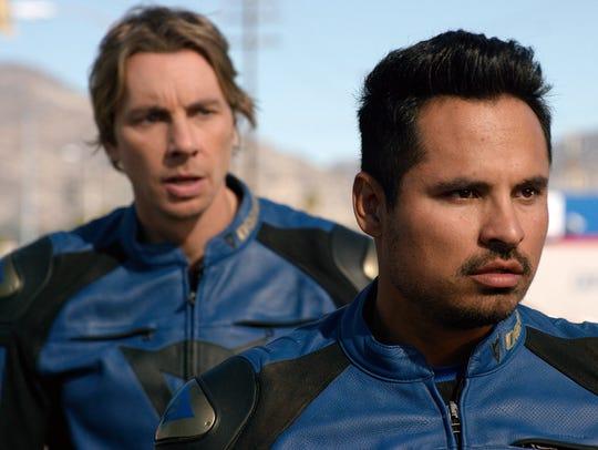 Jon (Dax Shepard, left) and Ponch (Michael Peña) roll