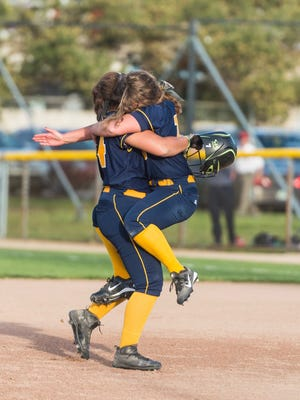 Olivia Nims ,left, and Erin Hunt of Webberville hug after their 1-0 Softball Classic first round win over Lakewood Monday May 15, 2017 at Ranney Park in Lansing.