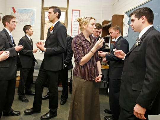 In this Jan. 31, 2008, file photo, a class of Mormon missionaries practice the Russian language with each other at the Mormon Missionary Training Center in Provo, Utah. Mormon missionaries will remain in Russia despite the country's new anti-terrorism law, which will put greater restrictions on religious work starting later this month. In a statement issued Friday, July 8, 2016, the Church of Jesus Christ of Latter-day Saints said that missionaries will respect a measure that Russian President Vladimir Putin signed into law this week. (AP Photo/George Frey, File)