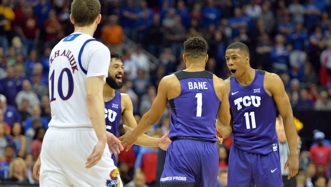 TCU Horned Frogs guard Desmond Bane (1) is congratulated by guard Brandon Parrish (11) after making the game-winning free throws in the second half against the Kansas Jayhawks during the Big 12 Championship Tournament at Sprint Center. TCU won 85-82.