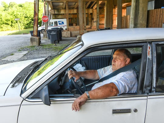 Sonny Duncan of Anderson waits in his car for a train