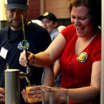 Emily Curry of Southern Prohibition Brewing pulls a beer during the third annual Hattiesburg Craft Beer Festival at the Train Depot. The Craft Beer Festival will be back on June 11 during this year's Festival-South.