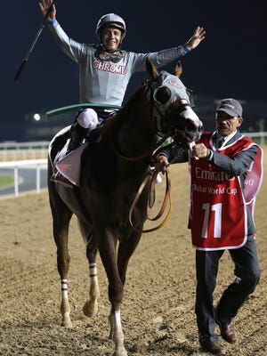 Victor Espinoza, jockey of the California Chrome from the U.S. celebrates after winning Saturday's Dubai World Cup.